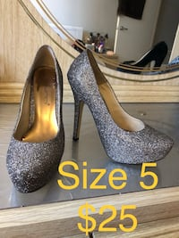 Size 5 party heals adapts to silver or gold never worn  Waterloo, N2J 4H2
