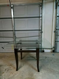 black metal framed glass top table Robins Air Force Base, 31098