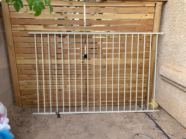 Metal fence.  Natural white