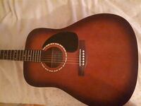 brown and black acoustic guitar 785 km