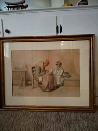 brown wooden framed painting of man and woman 42 km