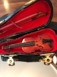Miniature wooden violin with case