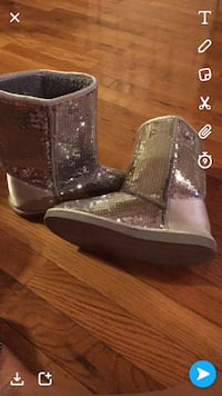 pair of gray sequin boots