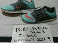 pair of men's teal-and-black Nike running shoes