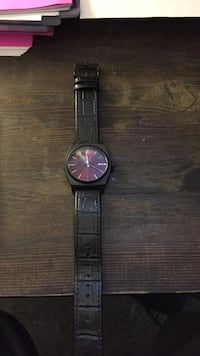 Red and black Nixon watch