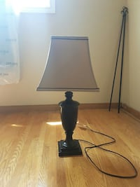 Beige and black corded down light table lamp