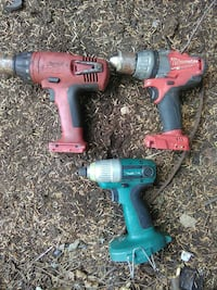 three Milwaukee and Makita cordless hand drills