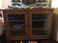 brown wooden TV hutch with flat screen television L'Île-Perrot, J7V 4W6