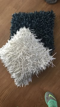 Two black and white fringe pillows