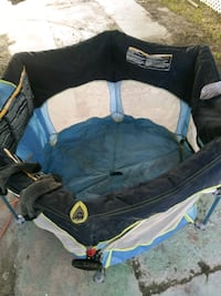 baby's blue and black travel cot