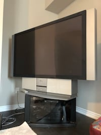 Black flat screen tv with white wooden tv stand 525 km