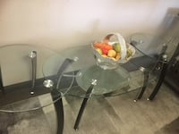 round glass top table with black metal base Houston, 77036