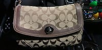 monogrammed brown and black Coach leather wristlet Omaha, 68154