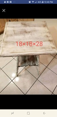 rectangular brown wooden table with black metal base Virginia Beach