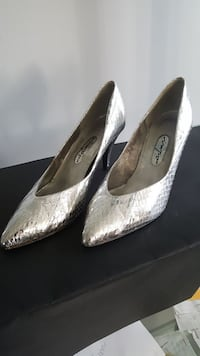 pair of women's silver leather pumps
