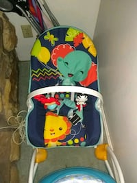 baby's blue and red bouncer