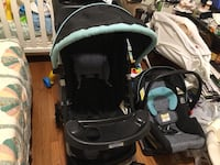 Black and blue stroller and car seat carrier