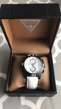 round silver chronograph watch with white leather strap Laval, H7X 3S8