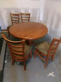 round brown wooden table with four chairs dining set Bluffton, 29910