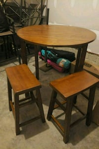 round brown wooden table with 2 chairs dining s 60 km
