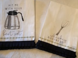Set of 2 new with out tags hand trimmed tea towels.
