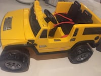 Yellow and black little-tikes hummer h2 ride on toy