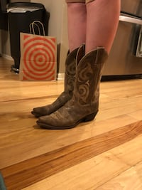 pair of brown leather cowboy boots Denver, 80238
