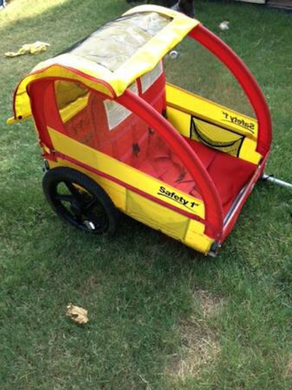 Used Yellow and red Safety 1st bicycle trailer for sale in