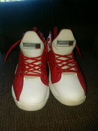 pair of red-and-white Nike basketball shoes SeaTac, 98198