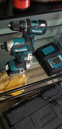 blue-and-black Makita cordless hand drill and impact wrench