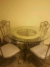 Glass top table with 4 metal chairs Denver, 80237