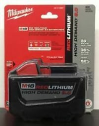 black and red Milwaukee M18 battery charger
