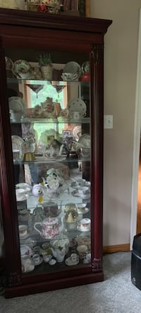 Lighted Cherry curio cabinet with 6 glass shelves plus 10 tea cup sets and 4 teapots can be bought together or apart Martinsburg, 25403