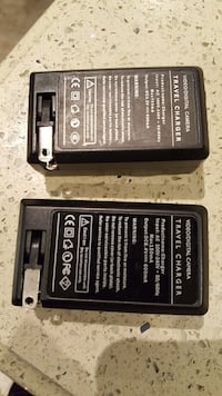 two black Travel chargers