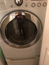 White front-load clothes dryer with stand must go ... 965 mi