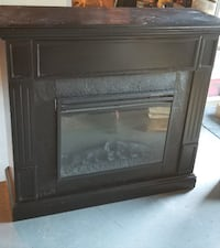 black wooden framed electric fireplace null