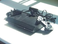 Super slim PS3 8/10 quality with 7 games! Toronto, M4H 1L3