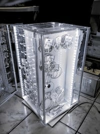 Lighted locking spinning acrylic countertop display cases.