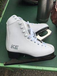 pair of white ice skates Delta, V4C 7E2