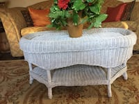 Antique white wicker coffee table.