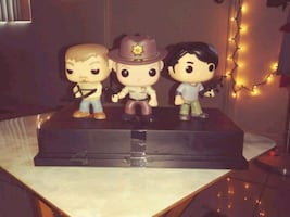 3 original Walking Dead Pop figures in a plastic container