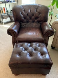 Tufted leather arm chair and ottoman