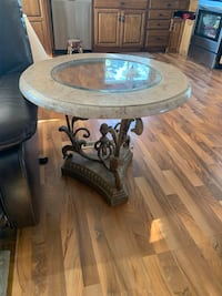 coffee table in good condition of metal at the bottom and marble with