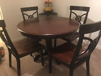 round brown wooden table with four chairs dining set Leesburg, 20175