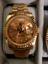 round gold-colored Rolex analog watch with link bracelet 568 km