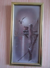 brown wooden framed painting of man London