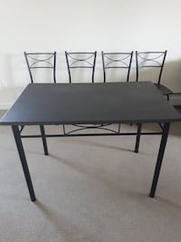 rectangular black wooden table with two chairs Nanaimo, V9S 5G1