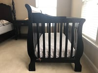 baby's black wooden crib 46 km