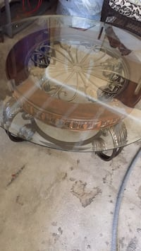 round clear glass top table with brown wooden base Oakville, L6M 3L9