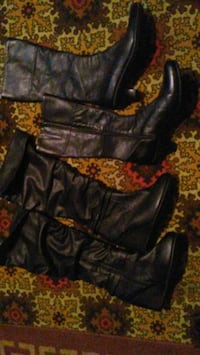 two pairs of black leather boots Saskatoon, S7L 6C9
